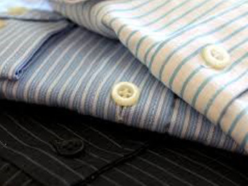 Men's shirts folded on top of each other